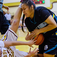 Navajo Prep Eagle Sequoia Wilson (34) grabs the ball away from Tohatchi Cougar Gabrielle Thomas (32) Thursday at Tohatchi High School.