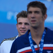 Michael Phelps, USA, leaves the podium followed by Gold medal winner  Paul Biedermann, Germany, after the Men's 200m Freestyle Final presentation at the World Swimming Championships in Rome on Tuesday, July 28, 2009. Photo Tim Clayton