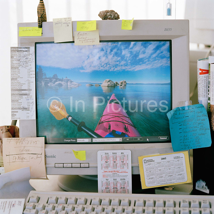 Computer monitor belonging to Elena Cheban,  projects manager. The image on the monitor reflects Elena's hobby and passion not to mention her dreams outside the office. From the series Desk Job, a project which explores globalisation through office life around the World.