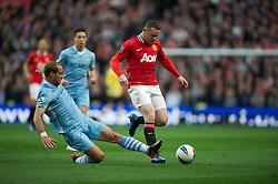 MANCHESTER, ENGLAND - Monday, April 30, 2012: Manchester City's Pablo Zabaleta in action against Manchester United's Wayne Rooney during the Premiership match at the City of Manchester Stadium. (Pic by Chris Brunskill/Propaganda)
