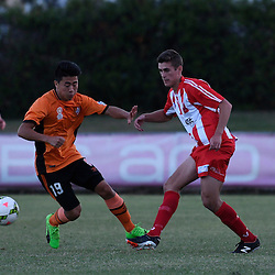 BRISBANE, AUSTRALIA - FEBRUARY 25: Tyler Wagstaffe of Olympic FC passes the ball under pressure from Nathan Yoon of Brisbane Roar during the NPL Queensland Senior Men's Round 1 match between Olympic FC and Brisbane Roar Youth at Goodwin Park on February 25, 2017 in Brisbane, Australia. (Photo by Patrick Kearney/Olympic FC)