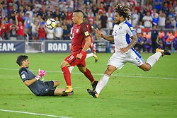 October 6, 2017 - Orlando, Florida, USA - Panama goalkeeper Jaime Penedo (1) blocks a shot by United States forward Bobby Wood (9) during a World Cup qualifying game at Orlando City Stadium on Oct. 6, 2017 in Orlando, Florida.  The US won 4-0....Zuma Press/Scott Miller (Credit Image: © Scott A. Miller via ZUMA Wire)