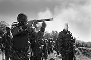NAIROBI, KENYA - DECEMBER 31, 2007: Teargas is shot into a crowd of protesters by the General Service Unit – a paramilitary wing of the Kenya Military and Police consisting of highly trained police officers and special forces soldiers. Despite news briefings for non-aggressive police action, a rising death toll reflected questionable methods from the General Service Unit, the paramilitary wing of Kenya's police charged with establishing order. A surge in violence left scores of people dead in Nairobi as defeated presidential candidate Raila Odinga prepared to declare himself head of state, after rejecting the victory of incumbent president Mwai Kibaki.