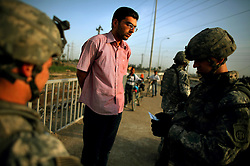 Engineers with 1st Platoon Alpha Co. 3-25 BSTB 2BCT 82nd Airborne Division carry out a snap morning checkpoint on Wednesday April 25, 2007 in a northern neighborhood in the Adhamiya district of Baghdad.