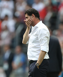 MOSCOW, July 1, 2018  Head coach Fernando Hierro of Spain reacts during the 2018 FIFA World Cup round of 16 match between Spain and Russia in Moscow, Russia, July 1, 2018. Russia won 5-4 (4-3 in penalty shootout) and advanced to the quarter-final. (Credit Image: © Cao Can/Xinhua via ZUMA Wire)