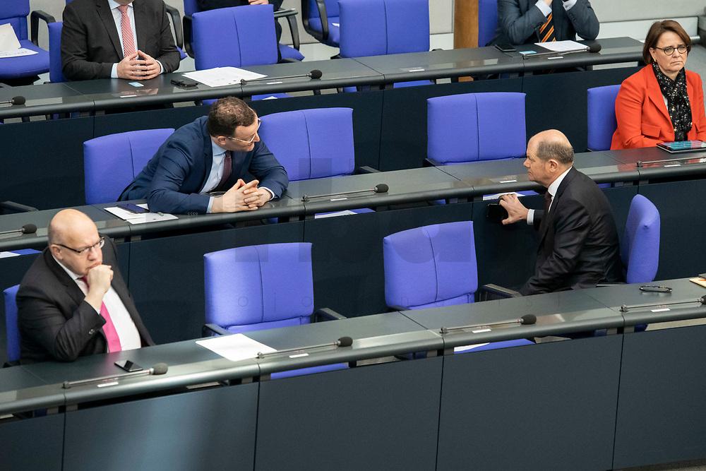 """25 MAR 2020, BERLIN/GERMANY:<br /> Peter Altmaier (L), CDU, Bundeswirtschaftsminister, Jens Spahn (M), CDU, Bundesgesundheitsminister, und Olaf Scholz (R), SPD, Bundesfinanzminister, im Gespraech. Um das Abstandsgebot zu beachten, ist nur jder dritte Platz in den Abgeordnentenreihen besetzt, Bundestagsdebatte zu """"COVID 19 - Kreditobergrenzen, Nachtragshaushalt, Wirtschaftsfonds"""", Plenum, Reichstagsgebaeude, Deutscher Bundestag<br /> IMAGE: 20200325-01-016<br /> KEYWORDS: Pandemie, Corona, Sitzung, Debatte, Gespräch"""