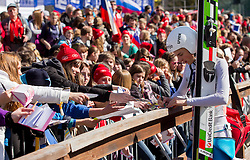 of Slovenia with young Fans  during Flying Hill Individual Qualifications at 1st day of FIS Ski Jumping World Cup Finals Planica 2012, on March 15, 2012, Planica, Slovenia. (Photo by Vid Ponikvar / Sportida.com)