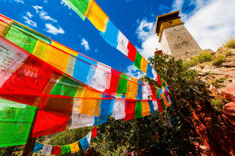 Prayer flags, Yambulakhang Palace, Tibet, China. The five colors of the prayer flags represent the five elements: blue for sky, white for wind, red for fire, green for water, and yellow for earth.