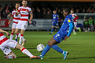 AFC Wimbledon defender Paul Osew (37) battles for possession during the EFL Sky Bet League 1 match between AFC Wimbledon and Doncaster Rovers at the Cherry Red Records Stadium, Kingston, England on 14 December 2019.