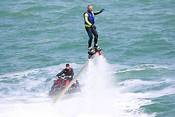 © Licensed to London News Pictures. 17/05/2015. Brighton, UK. A man plays with a Jet Board in the Brighton Sea, today May 17th 2015. The board is a powered by and connected to the Jet  Sky and propels the person attached to it out of the water into the air. Photo credit : Hugo Michiels/LNP