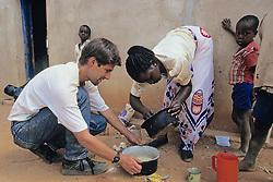 Dan Kammen And Woman Making Cake Batter