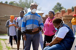 KRUGERSDORP, SOUTH AFRICA - APRIL 08: Health officials assist member of the public at a Covid19 screening centre in the Munsieville suburb on April 08, 2020 in Krugersdorp, Mogale South Africa. Under pressure from a global pandemic. President Ramaphosa declared a 21 day national lockdown, mobilising goverment structures accross the nation to combat the rapidly spreading COVID-19 virus, or Coronavirus. The lockdown requires businesses to close and the public to stay at home during this period, unless part of approved essential services.(Photo by  Dino Lloyd)