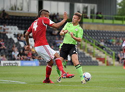 Bristol City's Liam Fontaine stops Forest Green Rovers Matt Taylor - Photo mandatory by-line: Dan Rowley/JMP  - Tel: Mobile:07966 386802 20/07/2013 -Forest Green Rovers  vs Bristol City  - SPORT - FOOTBALL - Forest Green Rovers - Bristol city  -