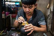Jeweler working in the Central Market. Battambang, Cambodia. December/2017.