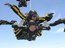 Former United States President George H.W. Bush jumps with the United States Army Golden Knights Parachute Team at the Bush Presidential Library near Houston, Texas on June 13, 2004 to celebrate his his 80th birthday. His jump was witnessed by 4,000 people including Actor and martial-arts expert Chuck Norris and Fox News Washington commentator Brit Hume. Both also participated in celebrity tandem jumps as part of the event. Bush made the jump harnessed to Staff Sergeant Bryan Schell of the Golden Knights. Bush was reportedly contemplating a free-fall jump, but officials said the wind conditions and low cloud cover made it too risky. Former Soviet President Mikhail Gorbachev was also on site. He was reportedly invited by Bush to join the jump, but said he had never parachuted and was too old to start. This was Bush'Äôs fifth jump. He also jumped with the Golden Knights on his 75th birthday. He said that he wanted to send a message to seniors that they ''still have a life.' Hand out Photo by US Army via CNP /ABACAPRESS.COM