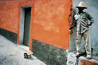 Teenager painting a wall in Oaxaca, Mexico