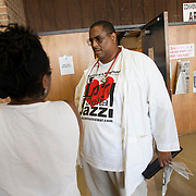 GREENVILLE, MS - September 3, 2005:  Dr. Ronald Myers, treats Hurricane Katrina evacuees in Greenville, Mississippi on September 3, 2005. As a doctor and advocate for the poor, he is treating evacuees from New Orleans and other parts of Louisiana and Mississippi in shelters and at homes where the evacuees have taken up residence. His personal home and his in-laws home were severely damaged and all are living in a Ramada Inn...