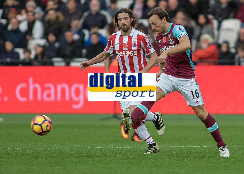 Football - 2016 / 2017 Premier League - West Ham United vs. Stoke City<br /> <br /> Mark Noble of West Ham  and Joe Allen of Stoke City at The London Stadium.<br /> <br /> COLORSPORT/DANIEL BEARHAM