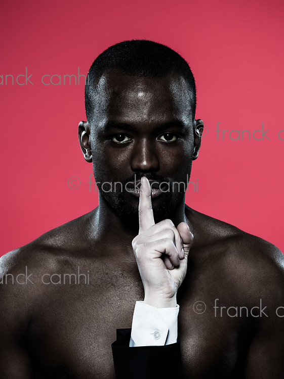 one african man hand on his mouth Freedom of speech concept