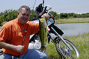 James Pratt bass fishing at a pond in south central Oklahoma. Rode BMW F650GS there to a remote pond.
