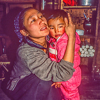 Dawa Sherpani  comforts her daughter in their kitchen in Namche Bazar, leading town of the Khumbu region, Nepal.