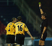 Fotball<br /> UEFA Cup 2004<br /> 21.10.2004<br /> Foto: SBI/Digitalsport<br /> NORWAY ONLY<br /> <br /> Panionios v Newcastle United<br /> <br /> Newcastle's Stephan Carr gets booked by referee Roberto Rosetti