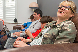 Eldest son Stevie, 15, Dad Chris, 44, , son Leo, 12, Mum Nancy, 43, all manage to be online simultaneously as the connected family enjoys social media, gaming and work. Real-life case study campaign, showcasing BT's complete Wi-Fi offering. London, May 16 2019.