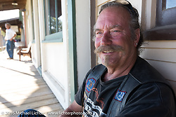 Cannonballer Rowdy Schenck after a great hosted dinner in historic downtown Dodge City, KS during the Motorcycle Cannonball Race of the Century. Stage-8 from Wichita, KS to Dodge City, KS. USA. Saturday September 17, 2016. Photography ©2016 Michael Lichter.