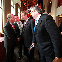 Fine Gael leader Enda Kenny giving the latest news to his disciples Gabriel Keating, Joe Carey and Pat Breen at the annual Shannon Chamber lunch in Dromoland on Thursday.<br /> Photograph by Yvonne Vaughan