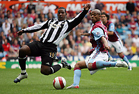 Photo: Rich Eaton.<br /> <br /> Aston Villa v Newcastle United. The Barclays Premiership. 27/08/2006. Titus  Bramble left of Newcastle United trys to block the shot of Aston Villas goalscorer and man of the match Luke Young