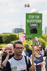 Environmental activists and local residents protest against the construction of the Silvertown Tunnel on 5th June 2021 in London, United Kingdom. Campaigners opposed to the controversial new £2bn road link across the River Thames from the Tidal Basin Roundabout in Silvertown to Greenwich Peninsula argue that it is incompatible with the UK's climate change commitments because it will attract more traffic and so also increased congestion and air pollution to London's most polluted borough.