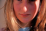 A793K2 Lower part of blonde girl's face with hair mouth and nose and eyes partially obscured