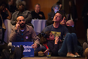 Guests watch the election coverage during the Dallas County Democratic watch party in Dallas, Texas on November 8, 2016. (Cooper Neill for The Texas Tribune)