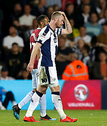 West Bromwich Albion's Chris Brunt leaves the pitch after being shown a red card for a second bookable offence by referee Chris Kavanagh