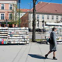 TIMISOARA, ROMANIA - APRIL 21:  A woman walks in front of a street book seller  on April 21, 2013 in Timisoara, Romania.  Romania has abandoned a target deadline of 2015 to switch to the single European currency and will now submit to the European Commission a programme on progress towards the adoption of the Euro, which for the first time will not have a target date. (Photo by Marco Secchi/Getty Images)