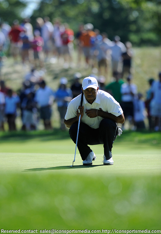 04 September 2010: Tiger Woods lines up a putt on the 13th during the Deutsche Bank Championship 2nd Round at TPC Boston in Norton, MA
