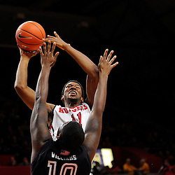 Kadeem Jack #11 of the Rutgers Scarlet Knights goes up against Mark Williams #10 of the Temple Owls during the second half of Rutgers men's basketball vs Temple Owls in American Athletic Conference play on Jan. 1, 2014 at Rutgers Louis Brown Athletic Center in Piscataway, New Jersey.