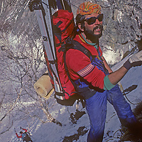 Using a short, thin rope, ski mountaineer AllanPietrasanta rappels from trees to tree into the Warwan River Gorge during a pioneering two-week ski expedition from Ladakh to Kashmir across India's Great Himalaya Range.