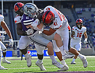 Linebacker Jacob Morgenstern #41 of the Texas Red Raiders and defensive lineman Tony Bradford Jr. #97 tackle running back Harry Trotter #2 of the Kansas State Wildcats during the first half at Bill Snyder Family Football Stadium on October 3, 2020 in Manhattan, Kansas.