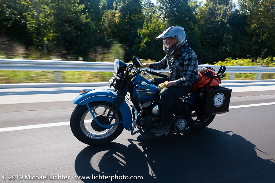 Kyle Rose riding down the highway during the Cross Country Chase motorcycle endurance run from Sault Sainte Marie, MI to Key West, FL (for vintage bikes from 1930-1948). Stage 4 saw a 315 mile ride from Urbana, IL to Bowling Green, KY USA. Monday, September 9, 2019. Photography ©2019 Michael Lichter.