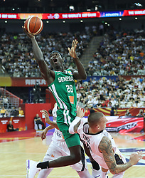 SHANGHAI, Sept. 7, 2019  Ibrahima Faye (Top) of Senegal goes up the basket during the group P match between Germany and Senegal at the 2019 FIBA World Cup in Shanghai, east China, on Sept. 7, 2019.   (Credit Image: RealTime Images)