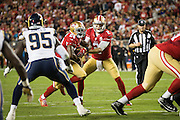 San Francisco 49ers quarterback Blaine Gabbert (2) hands the ball off to San Francisco 49ers running back Shaun Draughn (24) for a touchdown against the Los Angeles Rams at Levi's Stadium in Santa Clara, Calif., on September 12, 2016. (Stan Olszewski/Special to S.F. Examiner)