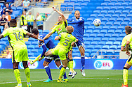 Cardiff City's Matthew Connolly (c) beats the Reading defence to head at goal. EFL Skybet championship match, Cardiff city v Reading at the Cardiff city stadium in Cardiff, South Wales on Saturday 27th August 2016.<br /> pic by Carl Robertson, Andrew Orchard sports photography.
