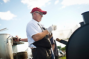 A chef prepares food during the Yum Yum Fest in Central Park on Sunday afternoon in Madison. A joint charity effort between the Madison Parks Foundation & Madison Area Chefs Network, this year marks the 3rd Annual end of summer celebration of local area food and drinks.