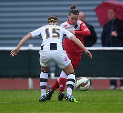 Bristol Academy's Loren Dykes gets the better of Notts County Ladies FC's Amy Turner - Photo mandatory by-line: Paul Knight/JMP - Mobile: 07966 386802 - 25/04/2015 - SPORT - Football - Bristol - Stoke Gifford Stadium - Bristol Academy Women v Notts County Ladies FC - FA Women's Super League