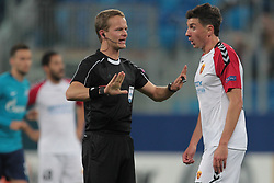 November 23, 2017 - Russia - Referee Bart Vertenen and defender Evgeni Novak of FC Vardar during UEFA Europa League Football match Zenit - Vardar. Saint Petersburg, November 23,2017 (Credit Image: © Anatoliy Medved/Pacific Press via ZUMA Wire)