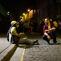 A couple of musicians perform an impromptu gig outside of Nation during Sound City in Liverpool, 3rd May, 2014.