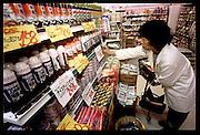 (MODEL RELEASED IMAGE). Sayo Ukita shops daily in the market area near the train station closest to her family's home in Kodaira City, Japan, outside Tokyo. There are many small specialized shops and a few small to medium sized supermarkets. (Supporting image from the project Hungry Planet: What the World Eats)