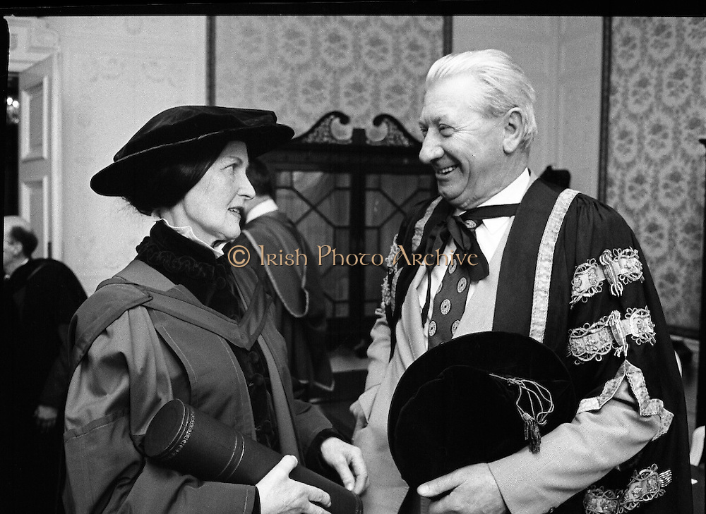 Honorary Degree For Joan Denise Moriarty.    (M65)..1979..05.04.1979..04.05.1979..5th April 1979..Joan Denise Moriarty, was an Irish ballet dancer, choreographer, teacher of ballet, and traditional Irish dancer and musician. She was the founder of professional ballet in Ireland. Her achievements were rewarded by the conferring of an honorary degree at University College ,Cork...Image of Ms Joan Denise Moriarty,recipient of the Honorary Degree, in conversation with Mr Tadhg O Ciarda, MA, PH D, Pro-Vice-Chancellor, University College,Cork.