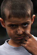 Litle Andre has is face dirt by sharcoal dust, during his vacations he's helping the grandmother, Idalina Moita, to catch the sharcoal. In the village of Pilado in the county of Marinha Grande, sharcoal production goes back to the sixth century, always executed by women, today due to unemployment, men are taking the responsability for this handicraft industry. Sharcoal is used as an alternative  power, most of all to grill.Paulo Cunha/4see